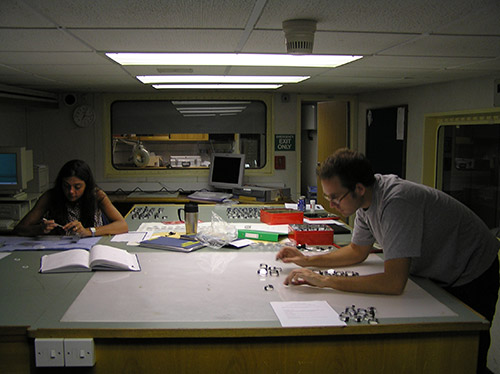 Scientists working in lab on AMT